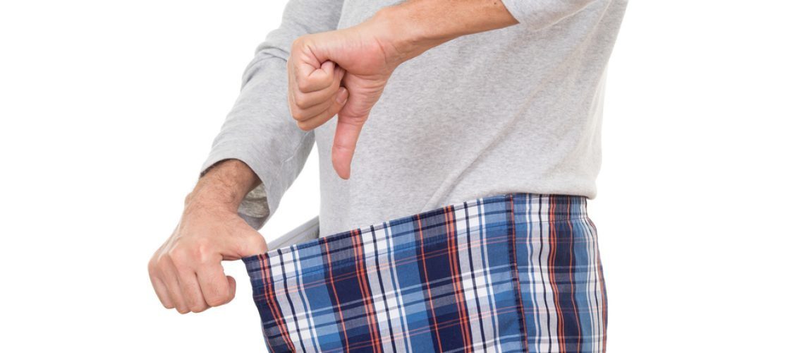 A guy not being to happy with what he finds in his boxer short