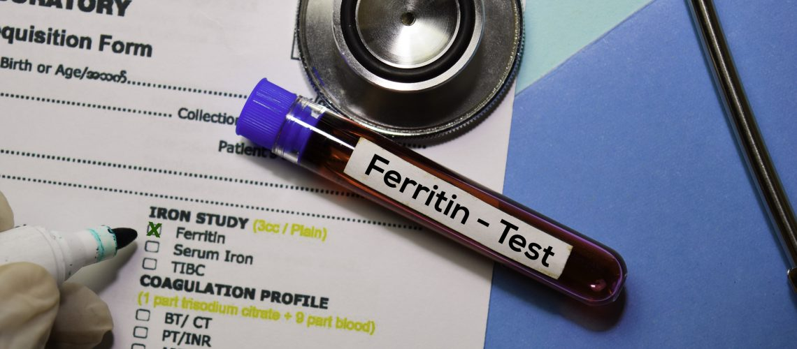 Ferritin - Test with blood sample. Top view isolated on office desk. Healthcare/Medical concept