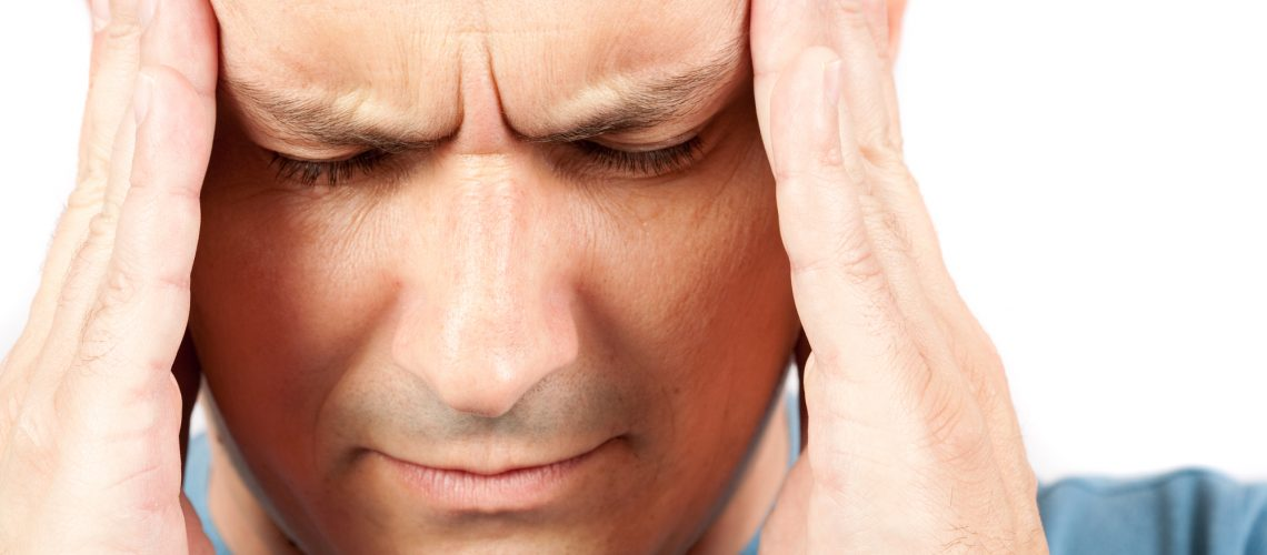 Young man with strong migraine, isolated on white background